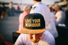 Man with hat that says love your neighbor