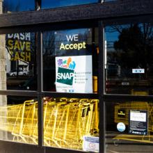 A sign saying the store accepts SNAP.