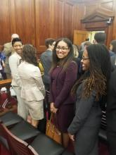A woman smiles in a courtroom.