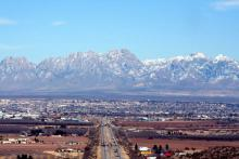 the mountains rise behind the town of Las Cruces, New Mexico.
